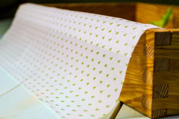 white-tissue-paper-with-green-printing@1x.jpg