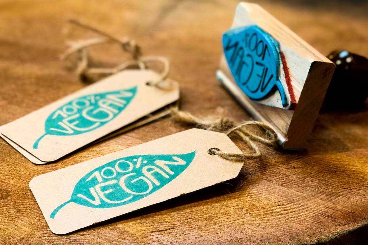 Custom Rubber Stamp With Green Ink Produced On Brown Kraft Luggage Hang Tag