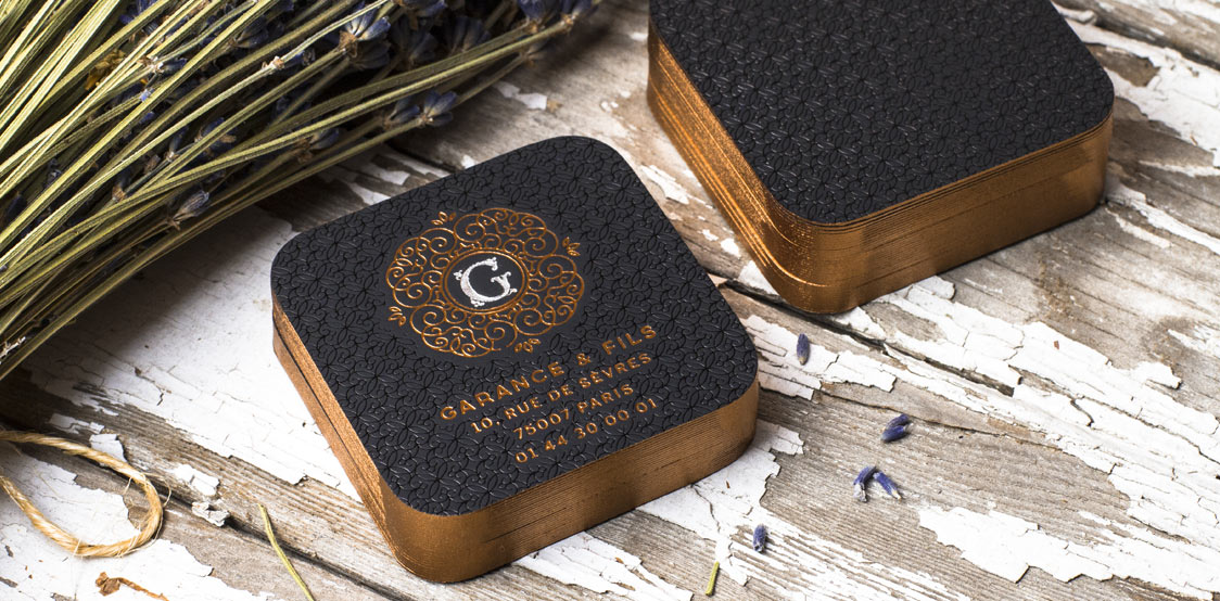 Premium black rounded business cards with copper painted edges