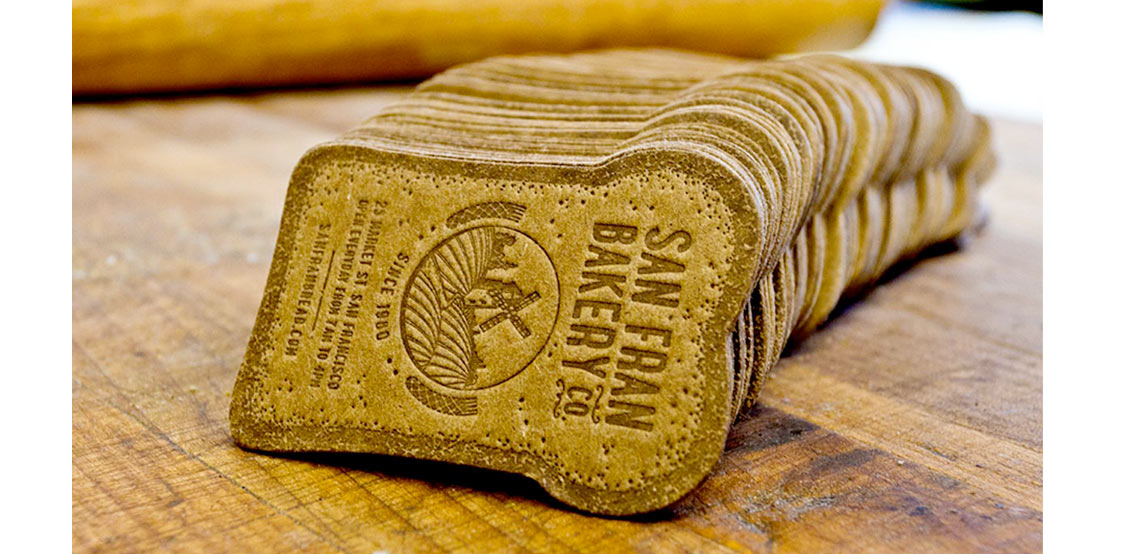 Creative business cards shaped as a bread slice