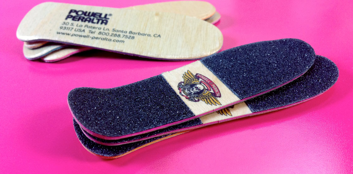 Creative business cards shaped as Skateboard