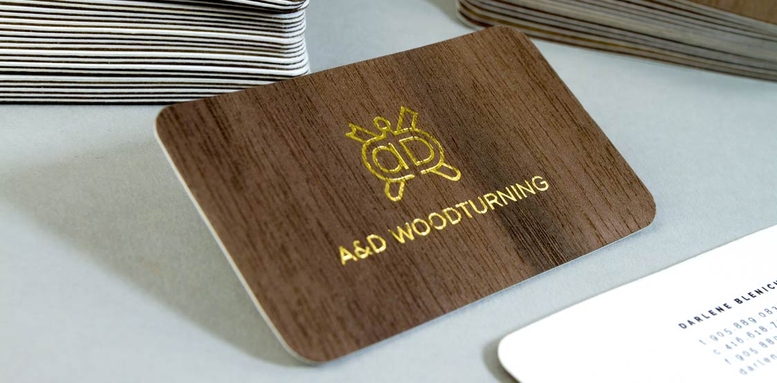 Wooden business card with rounded corners and gold foil